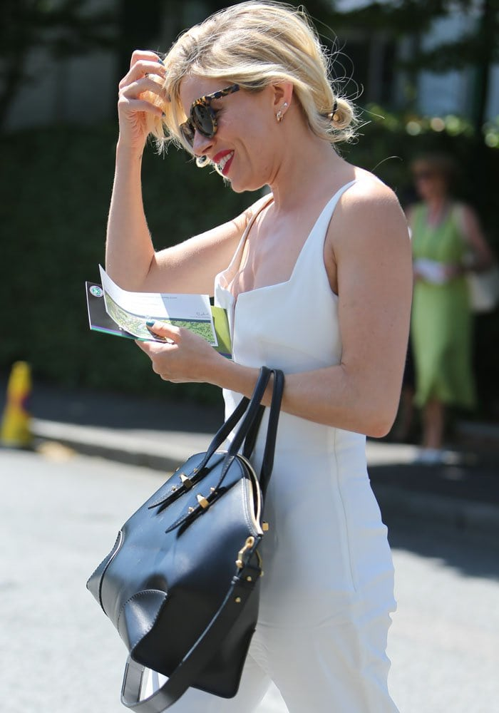 Sienna Miller proved to be the belle of the (tennis) ball as she turned heads at Wimbledon in a white Galvan jumpsuit