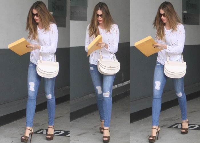 Sofia Vergara lets her brown hair hang long as she steps out for errands in a pair of platform heels