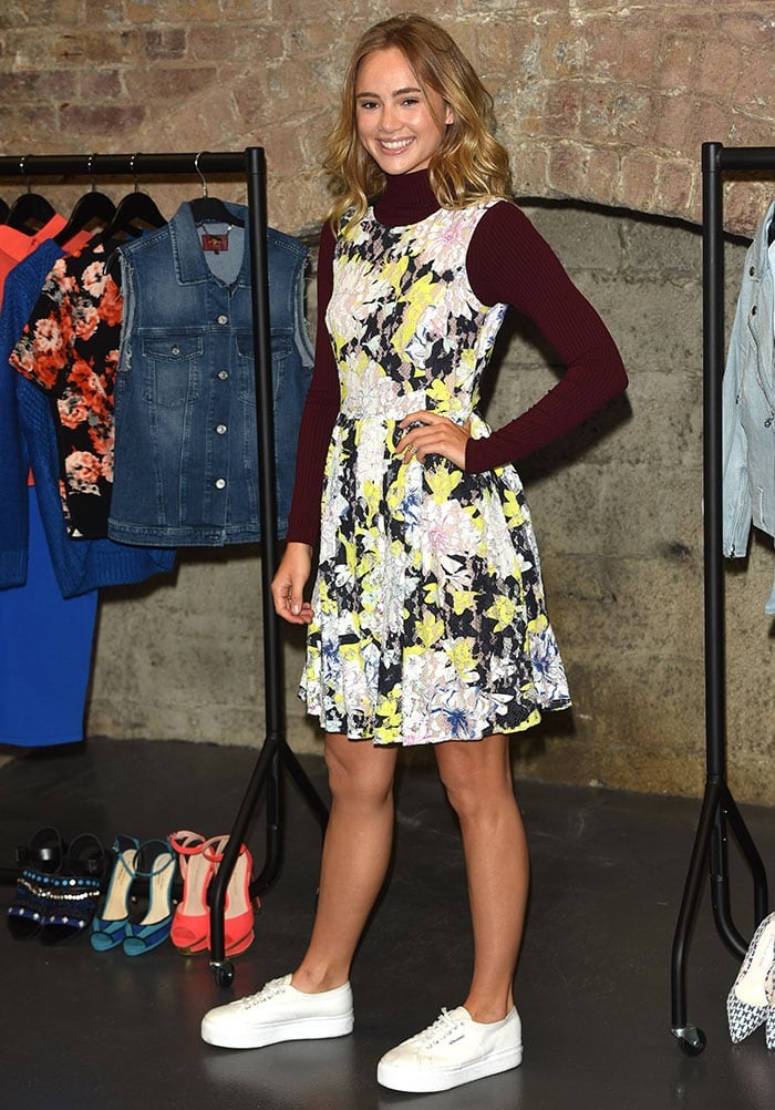 Suki Waterhouse flaunted her legs in a French Connection floral dress over a maroon Lipsy turtleneck sweater
