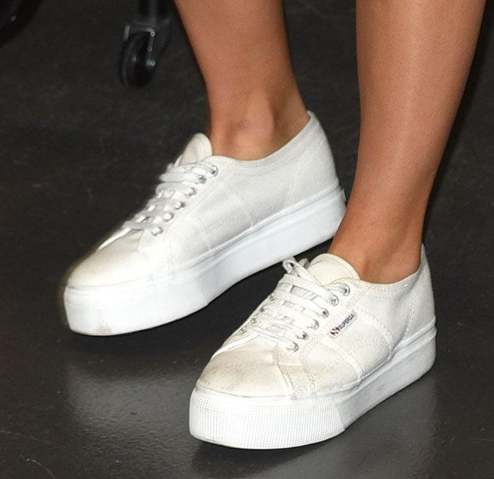Suki Waterhouse's white flatform sneakers by Superga