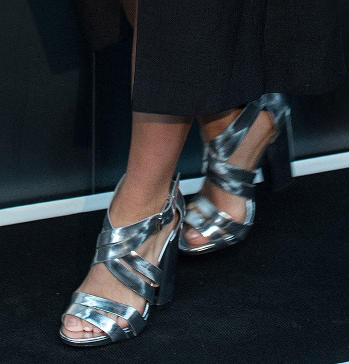 Suki Waterhouse's sexy feet in metallic strappy sandals