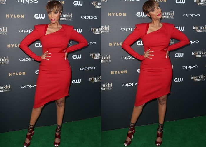 Tyra Banks poses and shows off her blunt bob on the green carpet