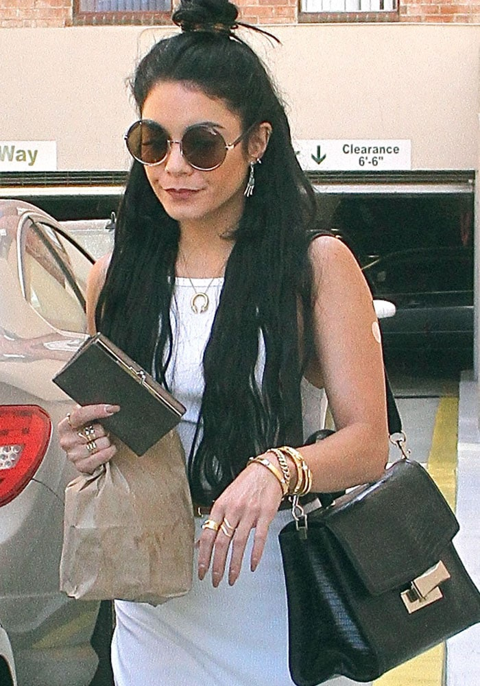 Vanessa Hudgens leaves a Los Angeles clinic with a bandage on her left arm