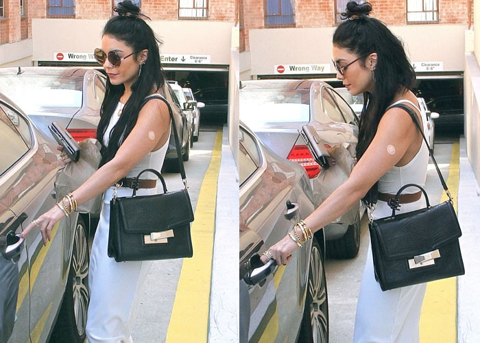 The bandage on the right arm of Vanessa Hudgens is in clear view as the singer leaves a clinic visit