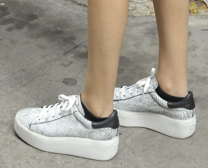Victoria Justice in crackled leather Ash trainers