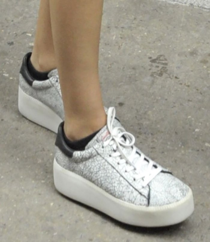 Victoria Justice wears platform sneakers by Ash