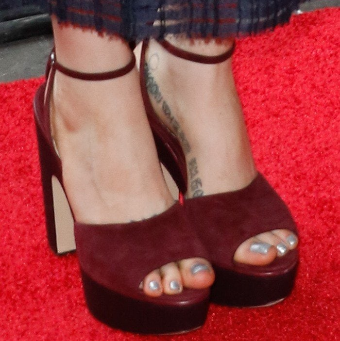 Zosia Mamet shows off her foot tattoos in Paul Andrew sandals