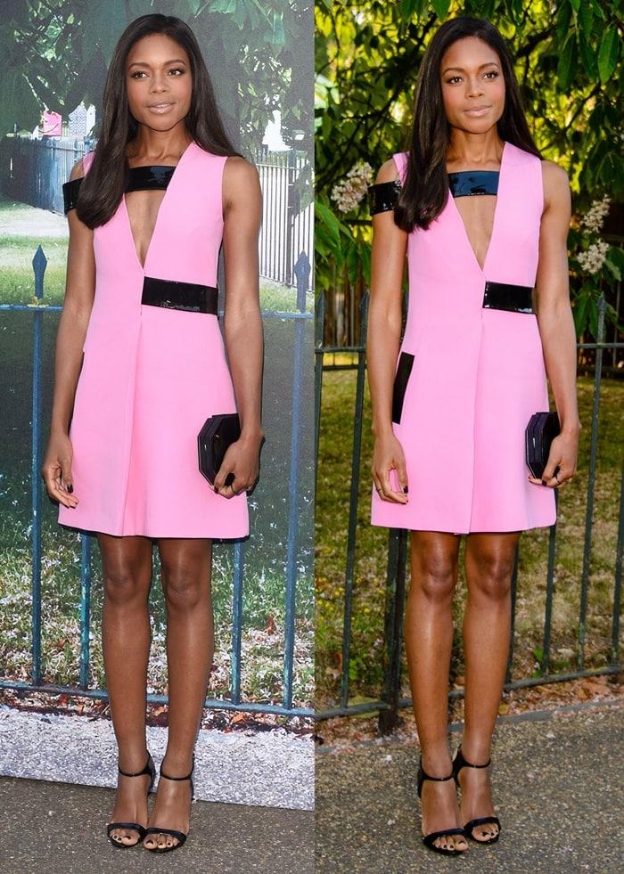 Naomie Harris flaunts her legs in a pink Christopher Kane shift dress