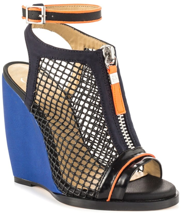 Peekaboo mesh construction and color-pop trim add rocker-chic edge to a lofty peep-toe sandal set on a bold wedge sole.