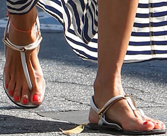 Alessandra Ambrosio shows off her neon coral pedicure in a pair of Gucci sandals