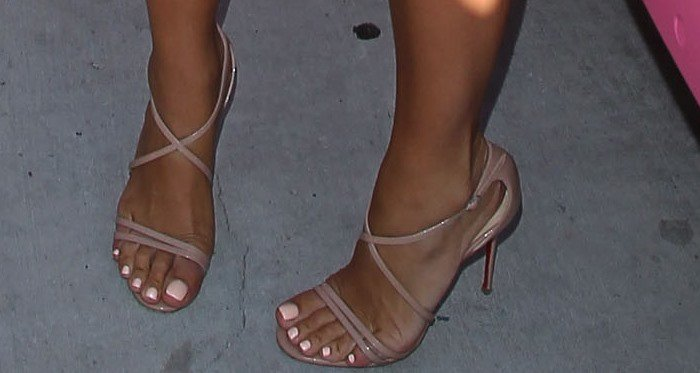 Amber Rose shows off her feet in nude shoes