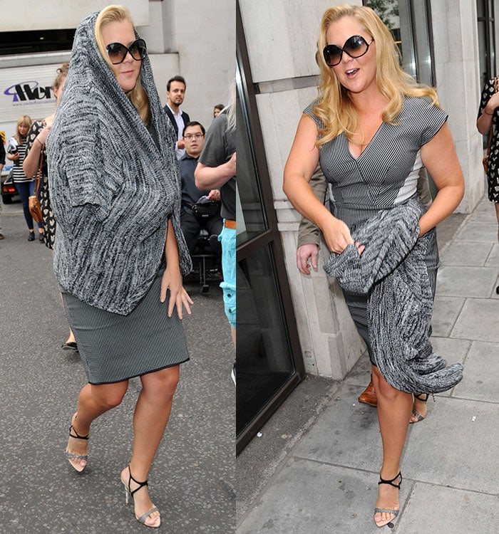 Amy Schumercovered up with a gray knit cardigan