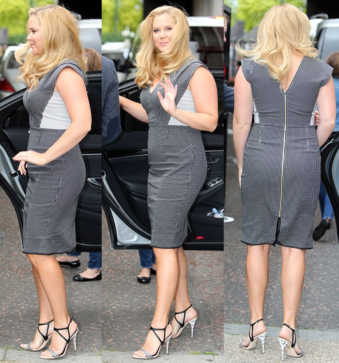 Amy Schumer flaunts her sexy legs ina figure-hugging monochrome structured dress