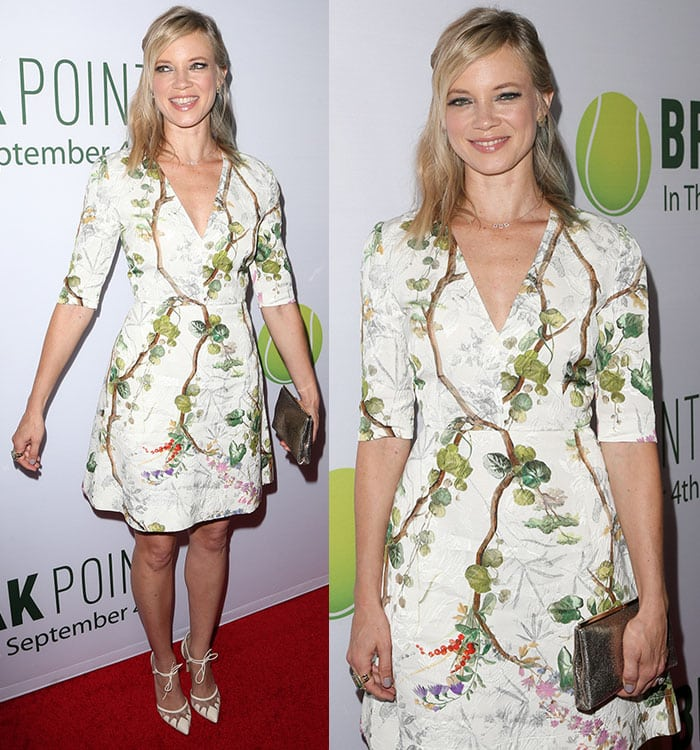 Amy Smart styled her hair in a loose half-up, half-down do with side-swept bangs