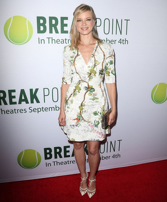 Amy Smart's flattering white A-line dress featuring floral and plant prints all over