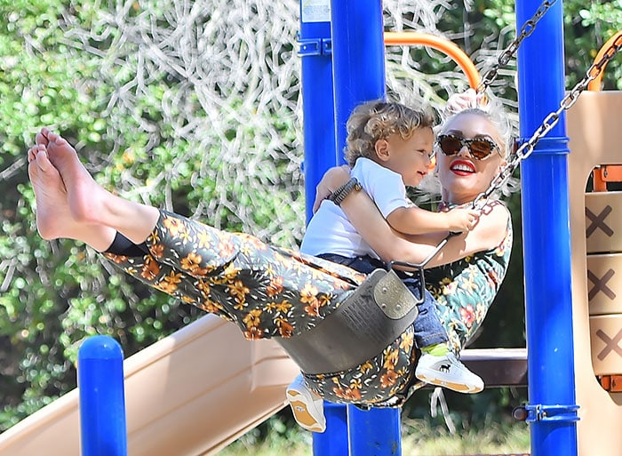 Gwen Stefani ditches her shoes as she spends time swinging with her son Apollo at a Los Angeles park