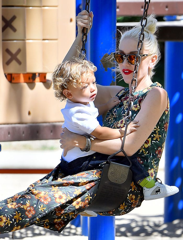 Gwen Stefani swings at the park with her youngest son, Apollo