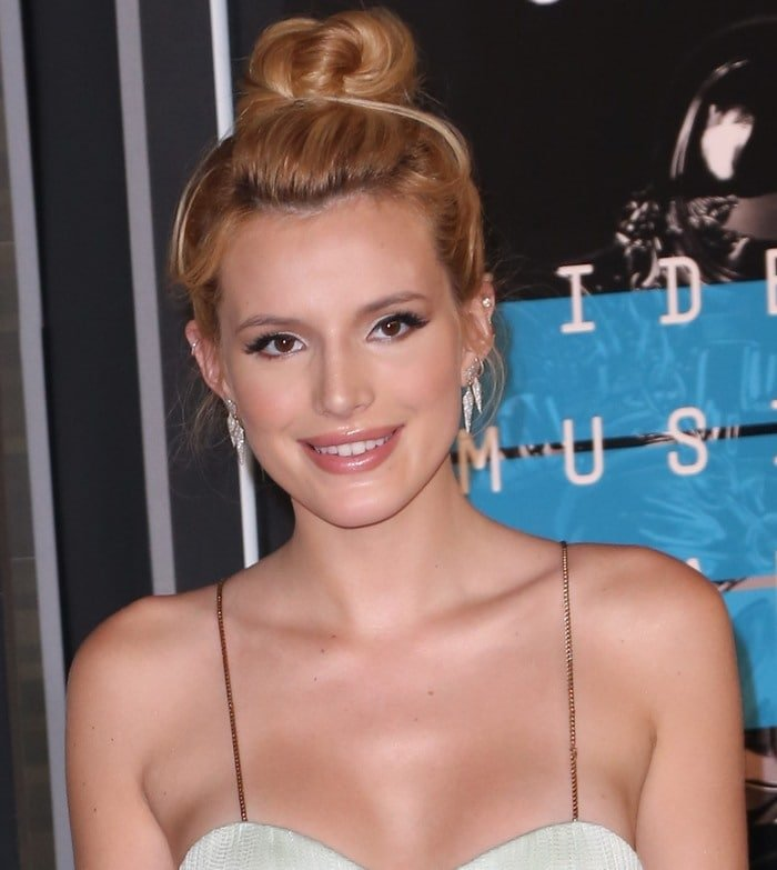 Bella Thorne's cute topknot and Ippolita earrings