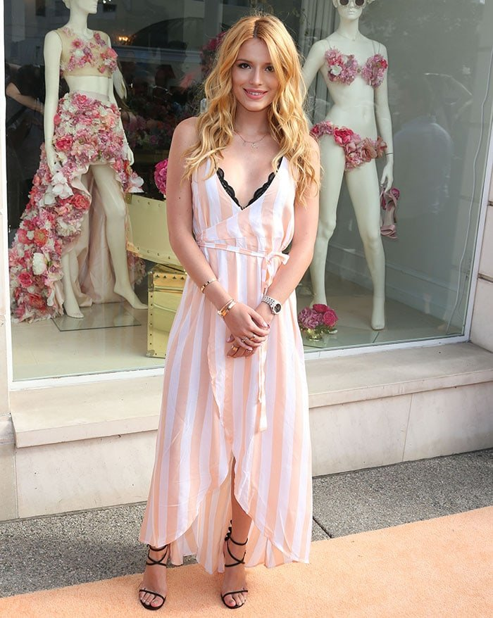 "Bella Thorne donned a Wildfox ""Atlantis"" dress featuring summer stripes in peach and white"