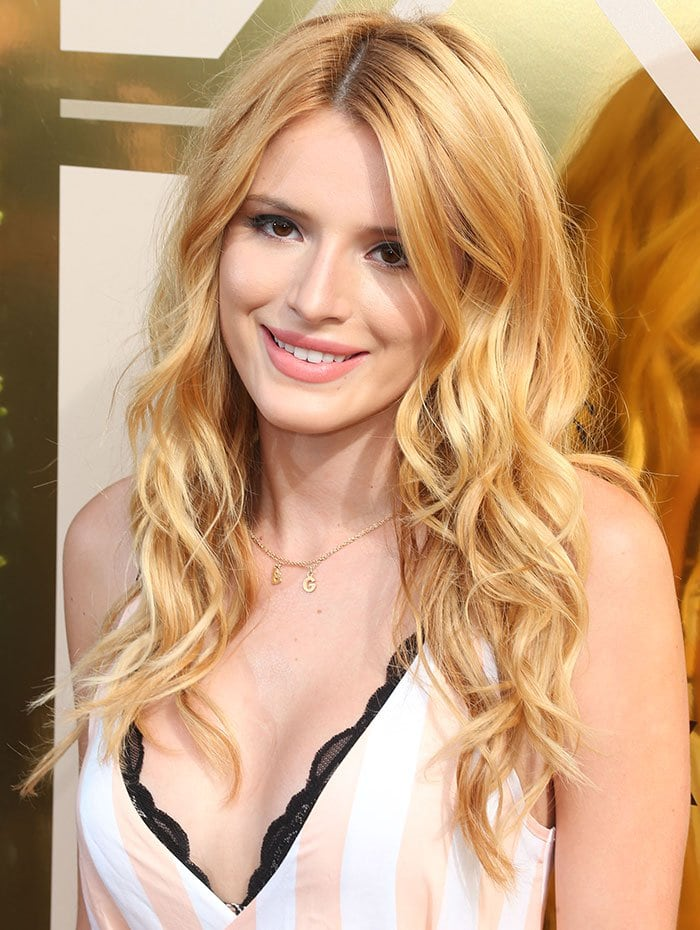 Bella Thorne styled her strawberry-blonde hair in loose curls