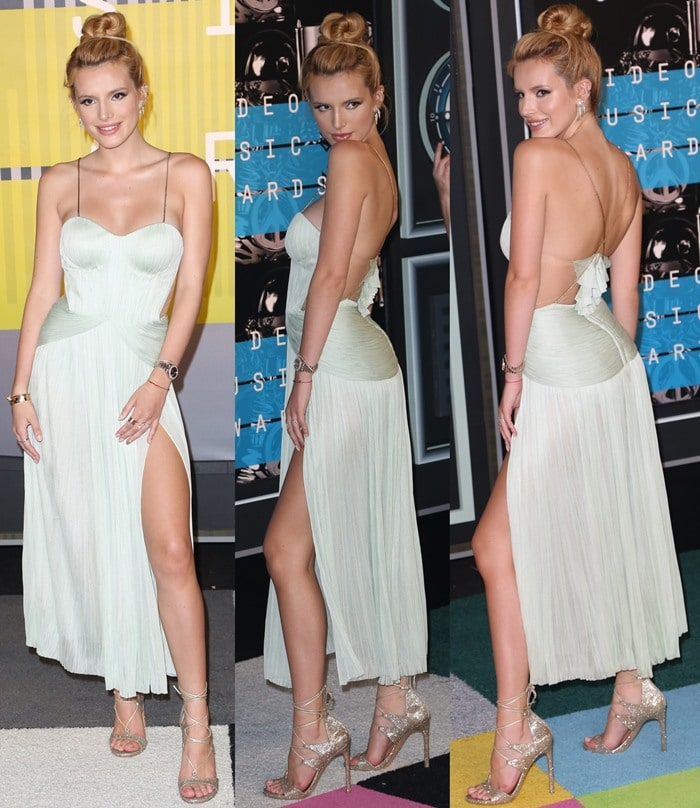 Bella Thorne flashed her legs in a silk-tulle bustier-style dress from Maria Lucia Hohan