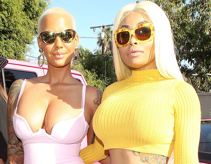 Amber Rose and her BFF Blac Chyna hand in hand at her meet and greet at Kitson on Melrose in Los Angeles on August 27, 2015