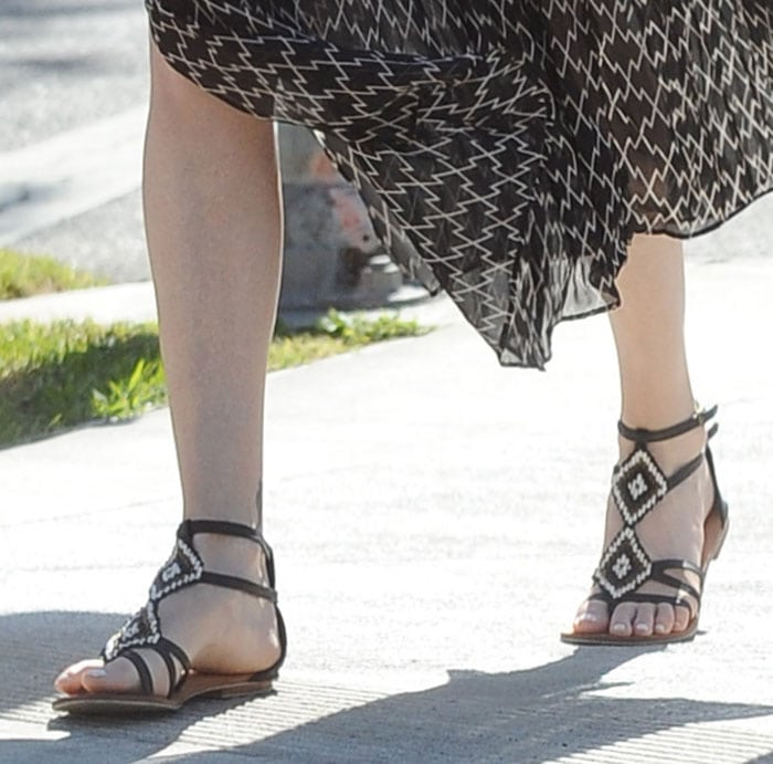 Charlize Theron wears Cocobelle sandals during a walk