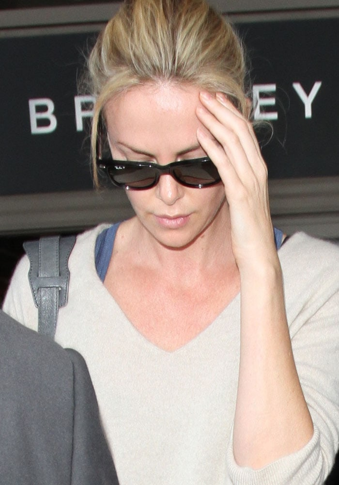 Charlize Theron wore a loose knit cardigan