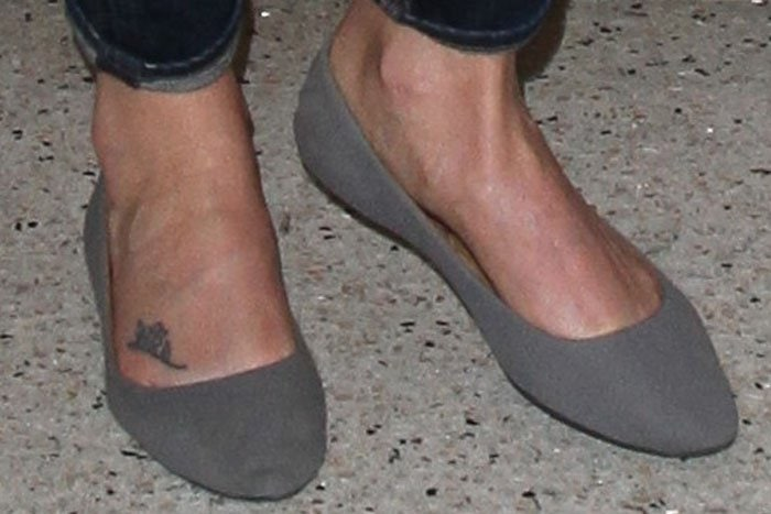 Charlize Theron wearing gray suede ballerina flats