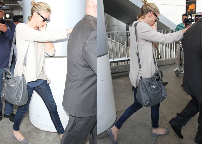 Charlize Theron arrives at Los Angeles International Airport (LAX) on July 31, 2015