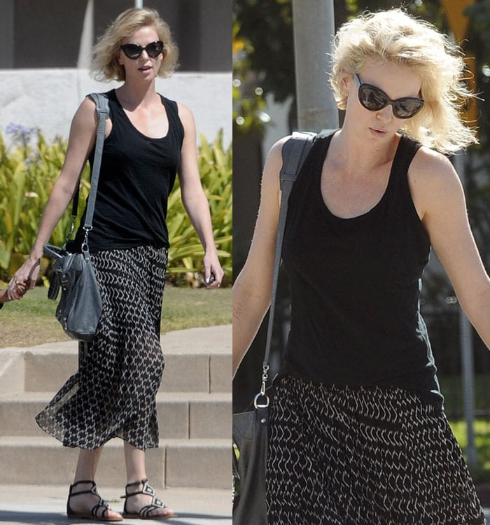 Charlize Theron wore an all-black-and-white boho look for her stroll, including a pair of beaded sandals