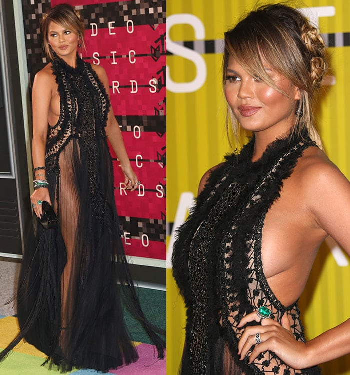 Chrissy Teigen shows sideboob in a sheer lace gown