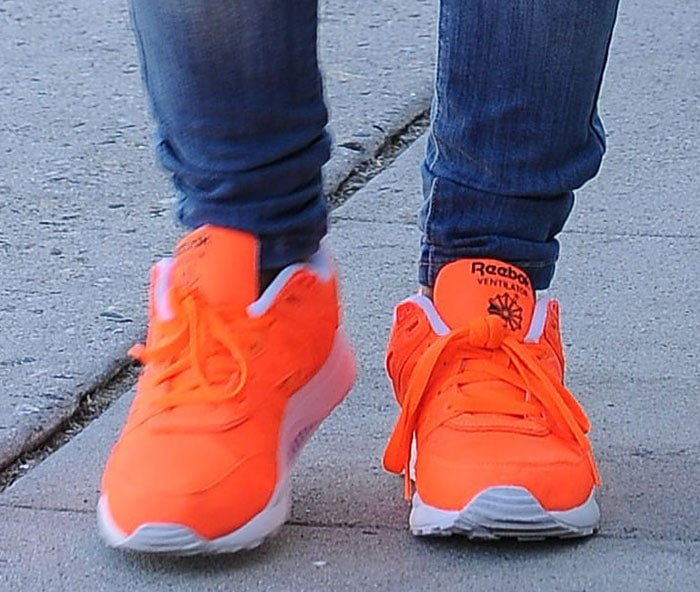 Christina Milian trades her towering heels for a comfortable and bright pair of Reebok sneakers