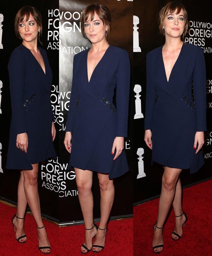 Dakota Johnson paraded her long legs in a pretty navy-blue coat dress