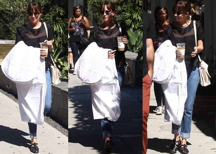 Dakota Johnson grabs her laundry and a cold coffee