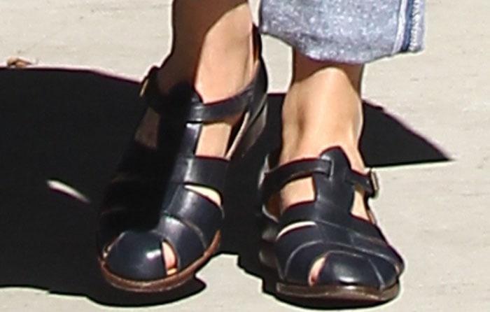 Dakota Johnson's black cutout sandal flats