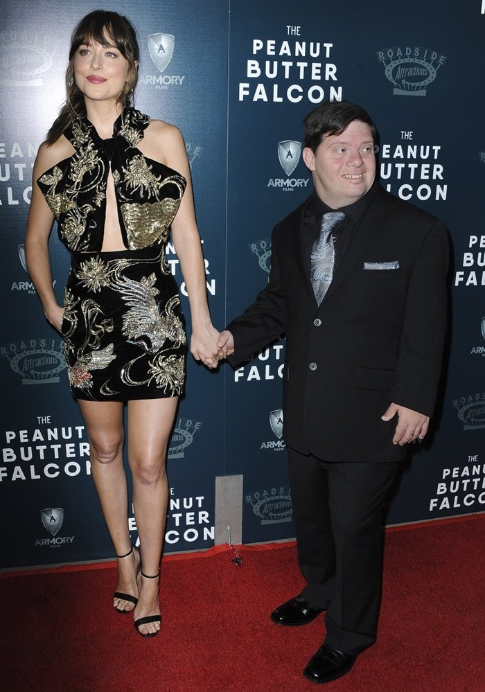 Dakota Johnson walked the red carpet at the premiere of her new movie The Peanut Butter Falcon with Zack Gottsagen