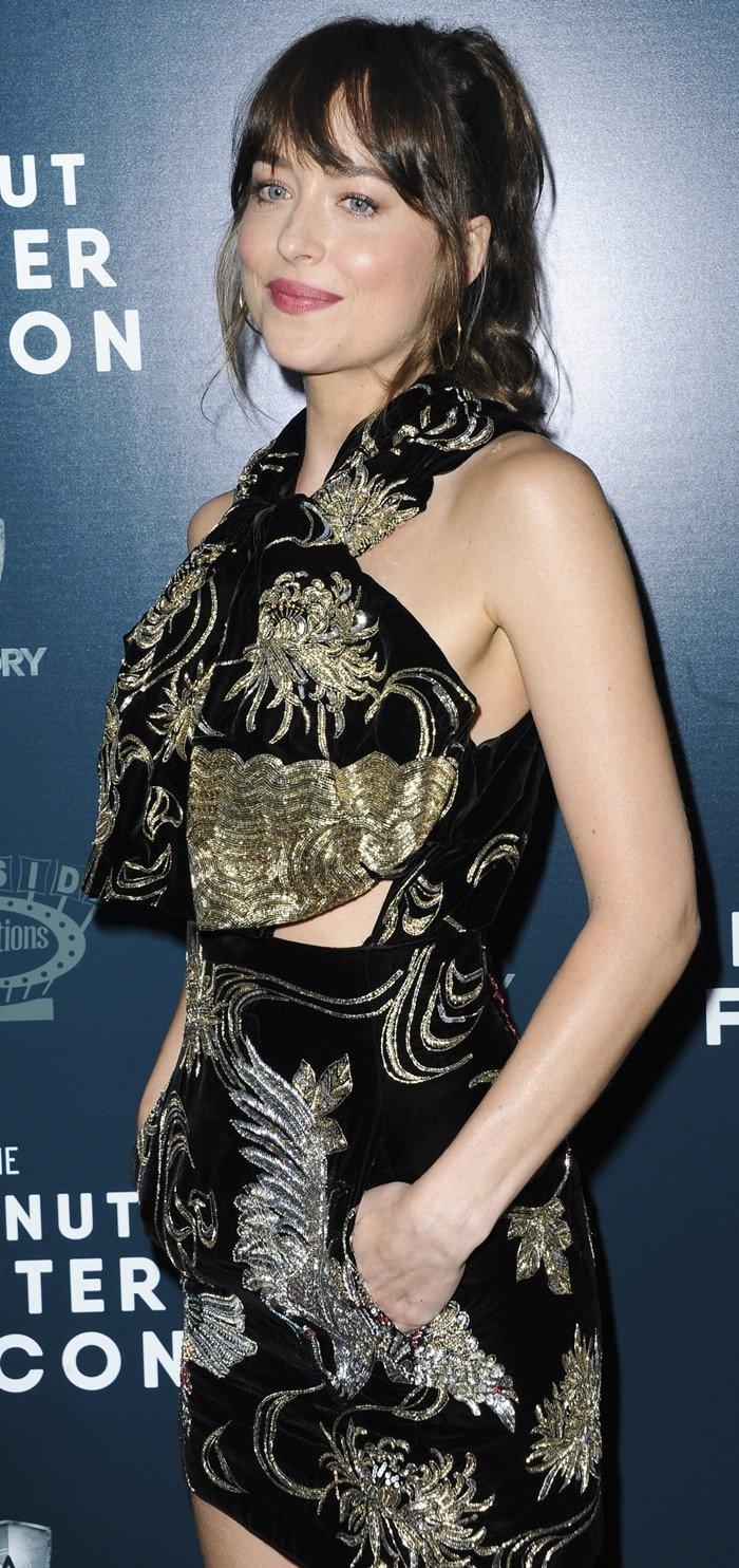 Dakota Johnson's sexy black velvet and gold sequin mini dress