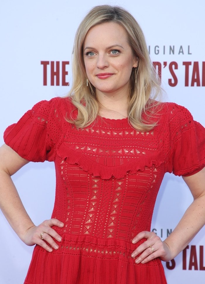 Elisabeth Moss wore a sexy dress crafted from pure cotton in a vibrant red hue