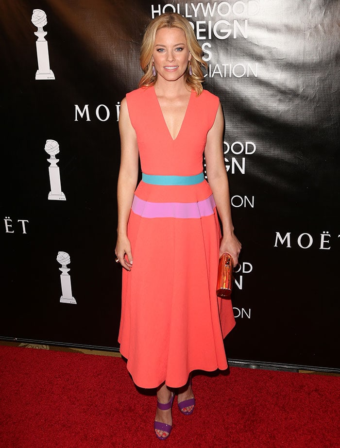 Elizabeth Banks in a brightly colored Roksanda peach midi dress