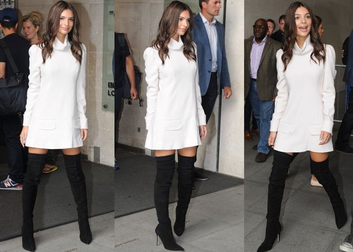 Emily Ratajkowski shows off her long legs in thigh-high black boots and a 60's style minidress