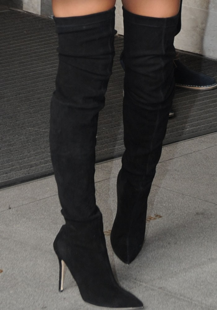 Emily Ratajkowski shows off the detailing of her Brian Atwood boots