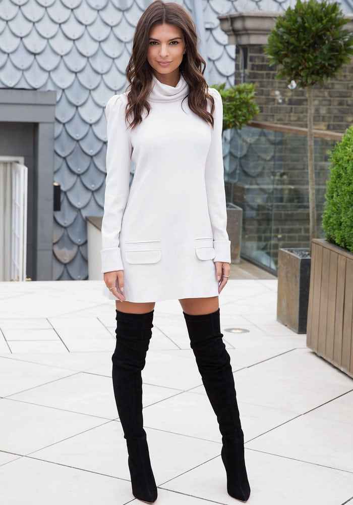 Emily Ratajkowski shows off her model prowess in a fierce monochrome look featuring black Brian Atwood boots