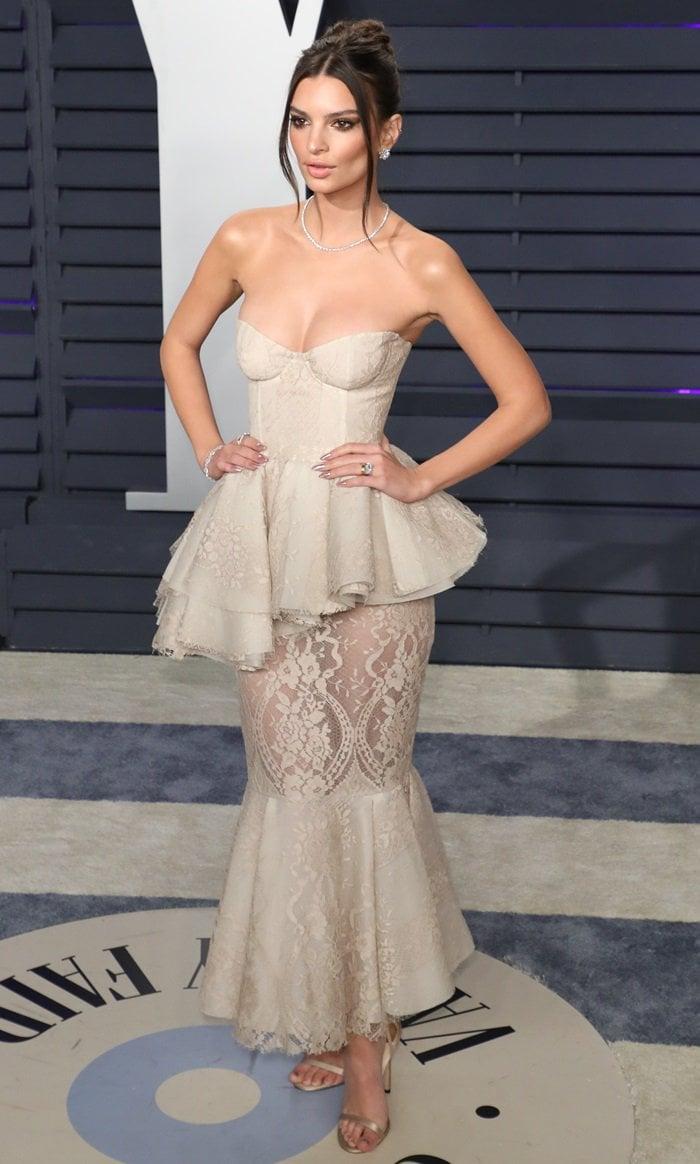 Emily Ratajkowski wearing Brock Collection's romantic cotton-lace 'Pierrete' dress