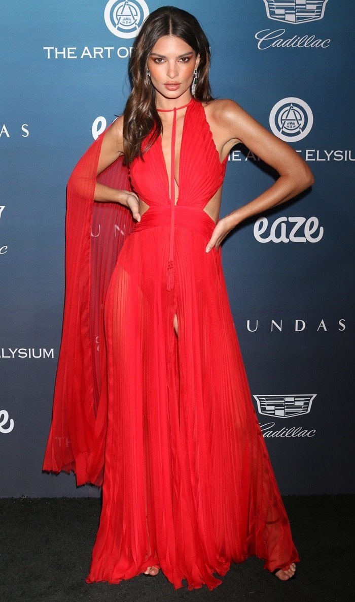 Emily Ratajkowski strikes a pose in a red Dundas dress and David Webb jewelry