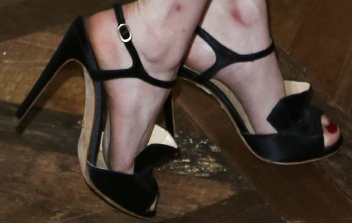 Emma Roberts shows off the ruffle detailing on her Jerome C. Rosseau sandals