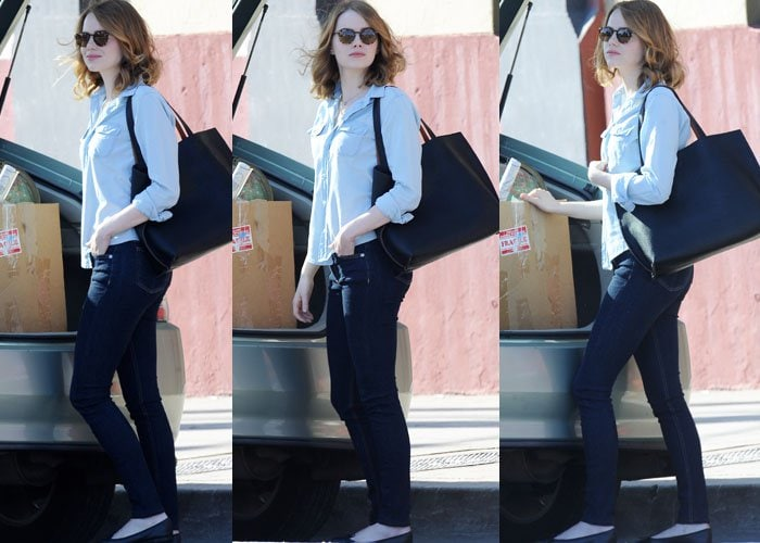 """Emma Stone keeps things business casual as she approaches a box of props on the set of """"La La Land"""""""