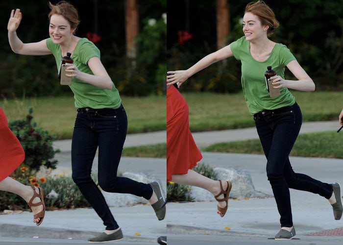 Emma Stone styled her green shirt with jeans and TOMS