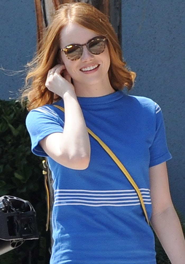 Emma wore a vintage-inspired blue dress