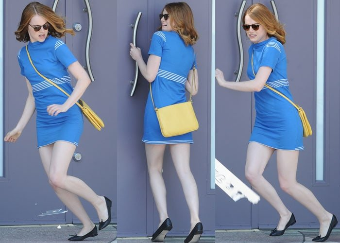 Emma wore a vintage-inspired blue dress, which she paired with black Repetto ballet flats and a yellow sling bag